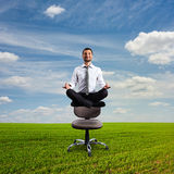 Businessman is meditating Stock Photo
