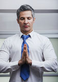 Businessman meditating Royalty Free Stock Image