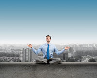 Businessman meditating Royalty Free Stock Photo