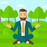 Businessman meditating in lotus pose. Royalty Free Stock Photo