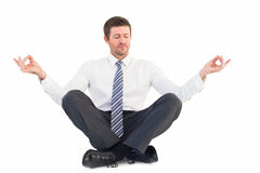 Businessman meditating in lotus pose Royalty Free Stock Photos