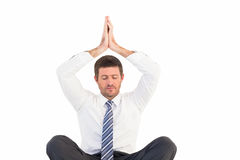 Businessman meditating in lotus pose Stock Photography