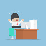 Businessman meditating in lotus position over his desk Royalty Free Stock Photography