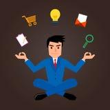 Businessman Meditating With Marketing Icons Royalty Free Stock Photo