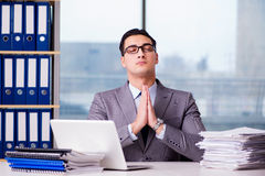 The businessman meditating in the office Royalty Free Stock Images