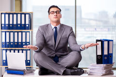 The businessman meditating in the office Royalty Free Stock Photo