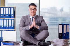 The businessman meditating in the office Royalty Free Stock Photos