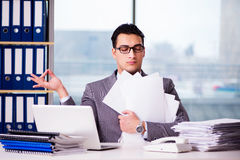 The businessman meditating in the office Royalty Free Stock Image