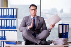 The businessman meditating in the office Stock Images