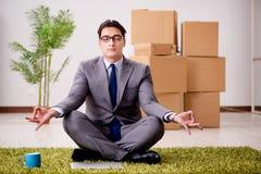 The businessman meditating on the office floor Stock Photos