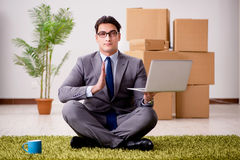 The businessman meditating on the office floor Royalty Free Stock Photography
