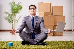 The businessman meditating on the office floor. Businessman meditating on the office floor stock photos