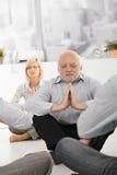 businessman meditating office senior Стоковые Фото