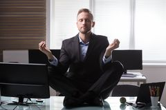 Businessman Meditating In Office royalty free stock photos
