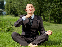 Businessman Meditating Outdoors Royalty Free Stock Photo
