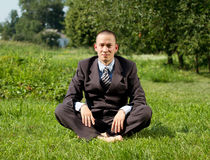 Businessman Meditating Outdoors Stock Photos