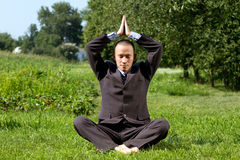 Businessman Meditating Outdoors Royalty Free Stock Photo