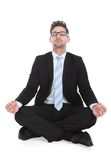 Businessman meditating over white background Stock Images