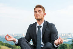Businessman meditating. Stock Photo