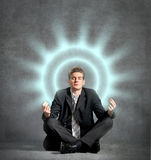 Businessman meditating royalty free stock photography