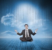 Businessman meditating and smiling Stock Image