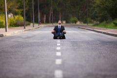 Businessman meditating Stock Photos