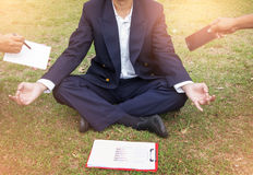 Businessman is meditating to relieve stress. young business man Stock Photos