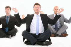 Businessman meditating on white Royalty Free Stock Images
