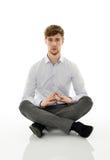 Businessman meditating on white Royalty Free Stock Image