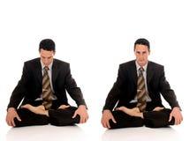 Businessman meditating yoga Royalty Free Stock Image