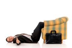Businessman meditating yoga Stock Images