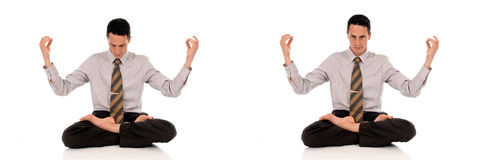 Businessman meditating yoga Stock Images