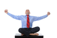 Businessman meditating in yoga lotus Royalty Free Stock Image