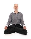 Businessman meditating in yoga lotus. Isolated on white background royalty free stock photos