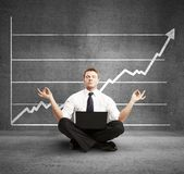 Businessman meditation. And profit on wall Stock Images