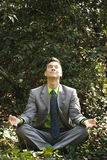 Businessman in Meditation Outside Royalty Free Stock Images