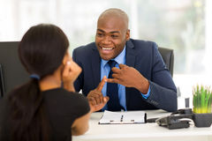 Businessman meeting client. Friendly african american businessman meeting with client Stock Photo