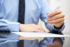 Businessman on meeting is commenting document Stock Photos