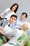 Businessman at the meeting with his employees Royalty Free Stock Photo