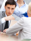 Businessman at the meeting with his employees Stock Photo