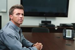 Businessman in meeting room Stock Images