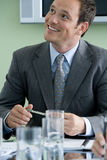 Businessman in meeting, smiling Stock Photography