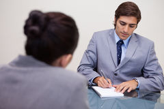Businessman in meeting taking notes Royalty Free Stock Photos