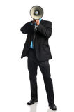 Businessman with megaphone. Standing and isolated on a white background stock photography