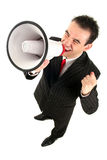 Businessman with Megaphone. Businessman Shouting Through Megaphone, standing over white background Royalty Free Stock Photo