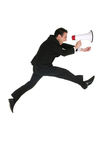 Businessman with Megaphone. Businessman Shouting Through Megaphone, jumping over white background Royalty Free Stock Images