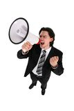 Businessman with Megaphone. Businessman Shouting Through Megaphone, standing over white background Royalty Free Stock Image