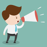 Businessman with a megaphone. Royalty Free Stock Photography