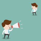 Businessman with a megaphone. Royalty Free Stock Photo
