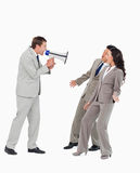 Businessman with megaphone yelling at associates. Against a white background Royalty Free Stock Photography